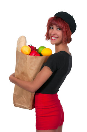Beautiful woman grocery shopping holding a brown paper bag photo