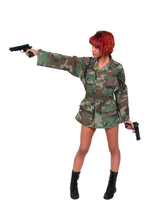 Beautiful young woman soldier with a gun photo