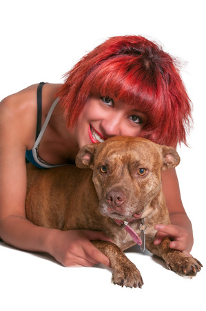 Beautiful young woman with her pit bull mix dog photo
