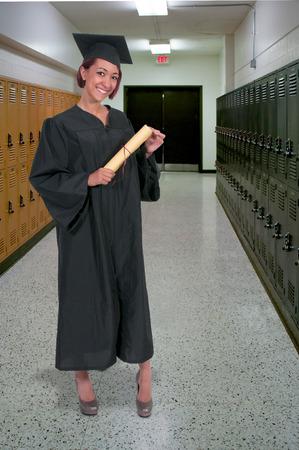 Young hispanic latino woman in her graduation robes photo