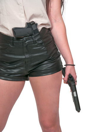 Beautiful woman with a loaded handgun pistol photo