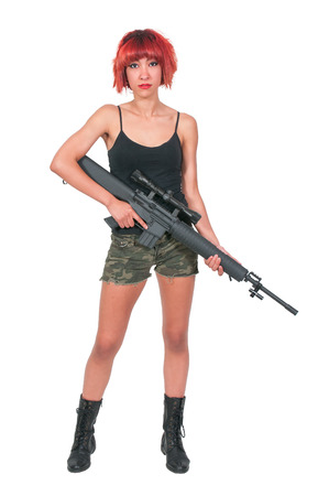 Beautiful young woman soldier with a M16 rifle