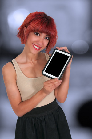 savvy: Beautiful technologically savvy woman using a tablet
