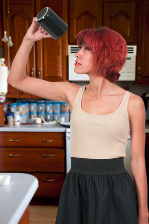 Beautiful young woman out of coffee in the morning photo