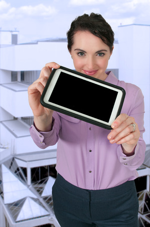 Beautiful technologically savvy woman using a tablet photo