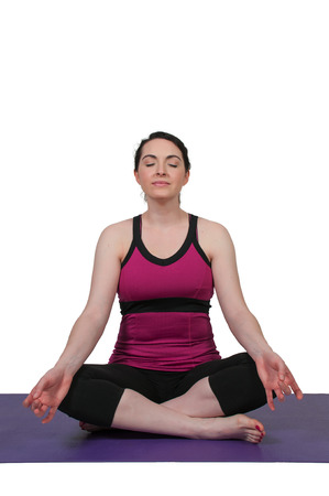 Beautiful woman doing her Yoga stance exercises photo