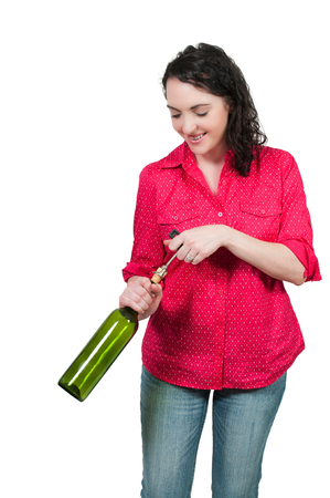 Beautiful woman opening a fine wine bottle photo
