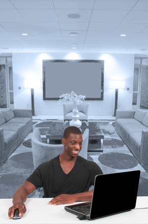 computer user: Black African American man business student computer user Stock Photo