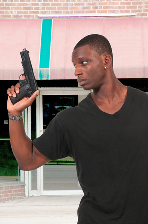 Police detective man on the job with a gun photo