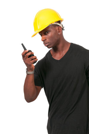 walkie talkie: Handsome black man construction worker talking on a walkie talkie Stock Photo