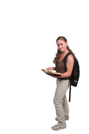 bookbag: Young college or high school woman with a book bag reading