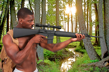 Handsome man holding an automatic assault rifle photo