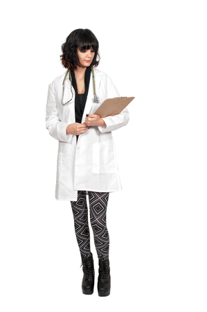 Beautiful young woman doctor in a lab coat holding a patient record