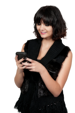 Beautiful woman texting with a cell phone photo