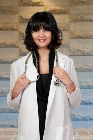 obstetrician: Female doctor with a stethoscope explaining a diagnosis Stock Photo