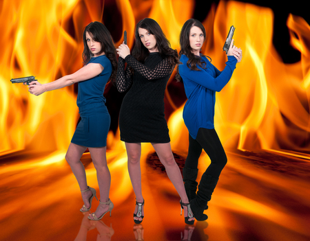 Beautiful police detective women on the job with guns in a fire