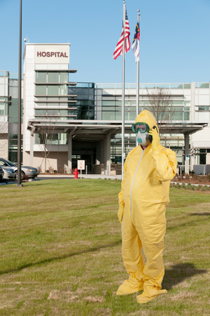 Man wearing a hazmat suit in the face of infectious disease photo