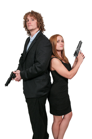 pistols: Young married couple with loaded handgun pistols