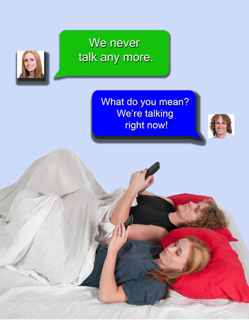 Young married couple texting in bed photo