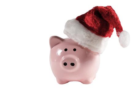 christmas debt: Pink piggy bank with a Santa Hat Stock Photo