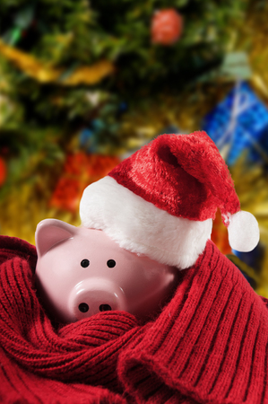 christmas debt: Pink piggy bank with a Santa Hat Stock Photo