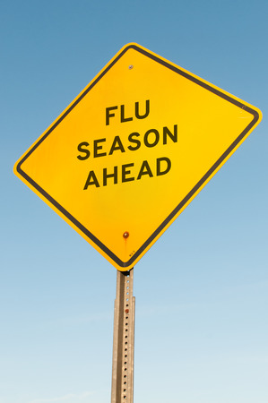 Yellow flu season ahead highway road sign Stock Photo - 34485374