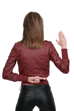 exaggerate: Beautiful woman with her fingers crossed behind her back Stock Photo