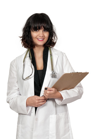 Beautiful young woman doctor in a lab coat holding a patient record photo