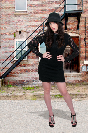 stilleto: Beautiful young sexy woman in a cloche hat, mini dress and heels