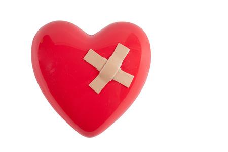 saint valentin coeur: Coeur bris� mand� par un couple de pansements adh�sifs Banque d'images