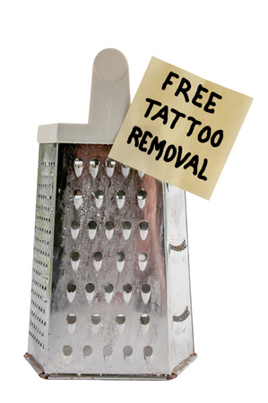 Free cheese grater tattoo removerfor the brave Stock Photo