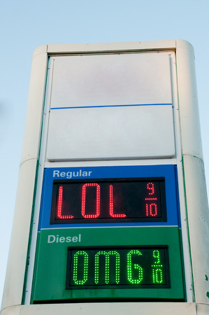 convenience store: Sign outside of a gas station convenience store that displays gasoline prices