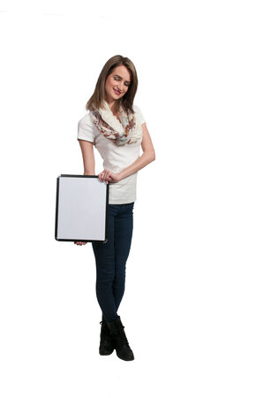 dry erase board: Beautiful young woman holding up a blank sign