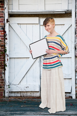 dry erase: Beautiful young woman holding up a blank sign