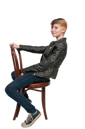 cane chair: Woman sitting in a cane back chair
