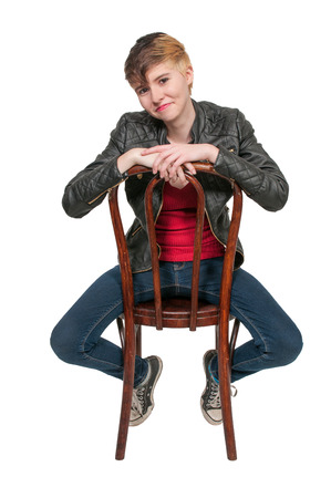 Woman sitting in a cane back chair photo