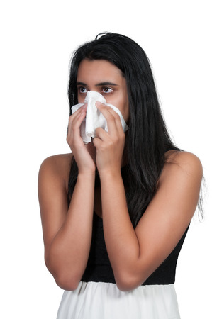 hayfever: Beautiful woman with a cold, hay fever or allergies blowing her nose
