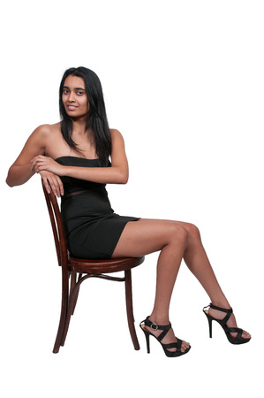 cane chair: Young Beautiful Woman with a lovely smile Stock Photo
