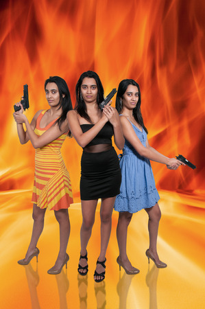 Beautiful police detective women on the job with guns