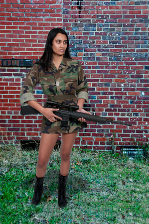 jewish group: Beautiful young woman soldier with a M16 rifle