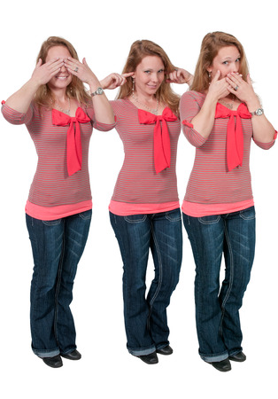 Woman doing the tradition see no evil hear no evil speak no evil gesture