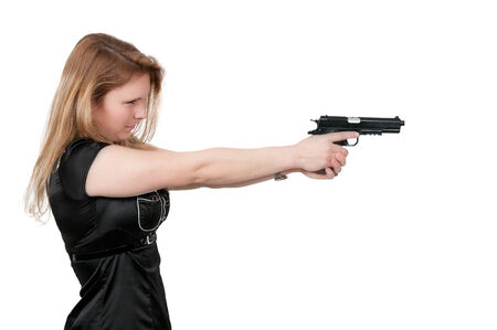 gun control: Beautiful woman with a loaded handgun pistol
