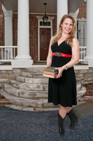 Beautiful woman holding a stack of library books photo