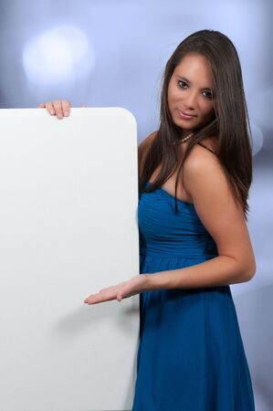 Woman standing behind a display board or wall