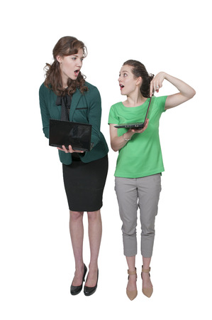 savvy: Beautiful computer savvy young women using laptops Stock Photo