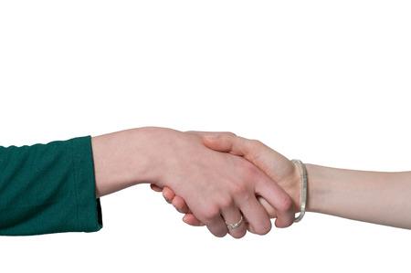 dando la mano: Pareja de mujeres de negocios dándose la mano en un acuerdo de negocios