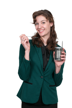 tin can: Woman eating food from a tin can Stock Photo
