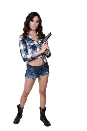 undercover agent: Beautiful young woman holding a loaded handgun Stock Photo