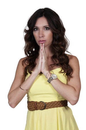 forlorn: Beautiful woman with her hands clasped in despair Stock Photo