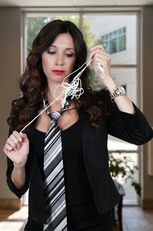 jumbled: Beautiful woman with tangled headphones in a twisted mess